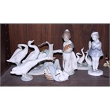 Three Lladro porcelain figures of geese, a similar Nao figure, a Lladro figure of a girl and a