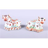 """A pair of Delft floral decorated models of cattle, 4"""" long (damages)"""