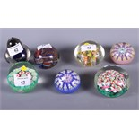 Four modern millefiore decorated paperweights and three others