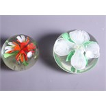 Two large Baccarat style floral decorated paperweights