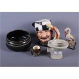 """A Royal Doulton character jug, """"The Trapper"""", a similar miniature character jug, a Doulton stoneware"""