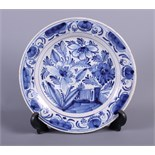 """An 18th century blue and white Delft plate with tree and fence decoration, 9"""" dia (hair crack)"""
