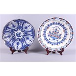 """An 18th century Delftware shallow dish with Imari style decoration, 13 1/2"""" dia (restored), and a"""