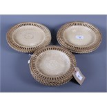 A set of eight 19th century circular salt glazed ribbon plates with basket weave moulded centres