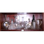 A Venetian two-handle glass decanter decorated corrugated trails and engraved with a windmill, a