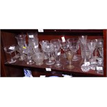 A large collection of assorted drinking glasses, etc