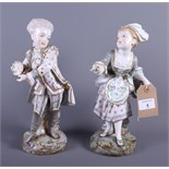 """A pair of Continental porcelain figures of a boy and girl in 18th century attire, 12"""" high"""
