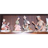 Four Capodimonte figures of a street musician, lady on a bench, an old seaman and three children