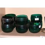 Eleven plain dark green glass finger bowls