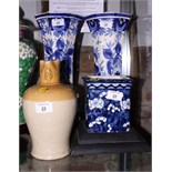 """A pair of blue and white octagonal waisted vases, 15"""" high, a smaller, similar square planter and"""