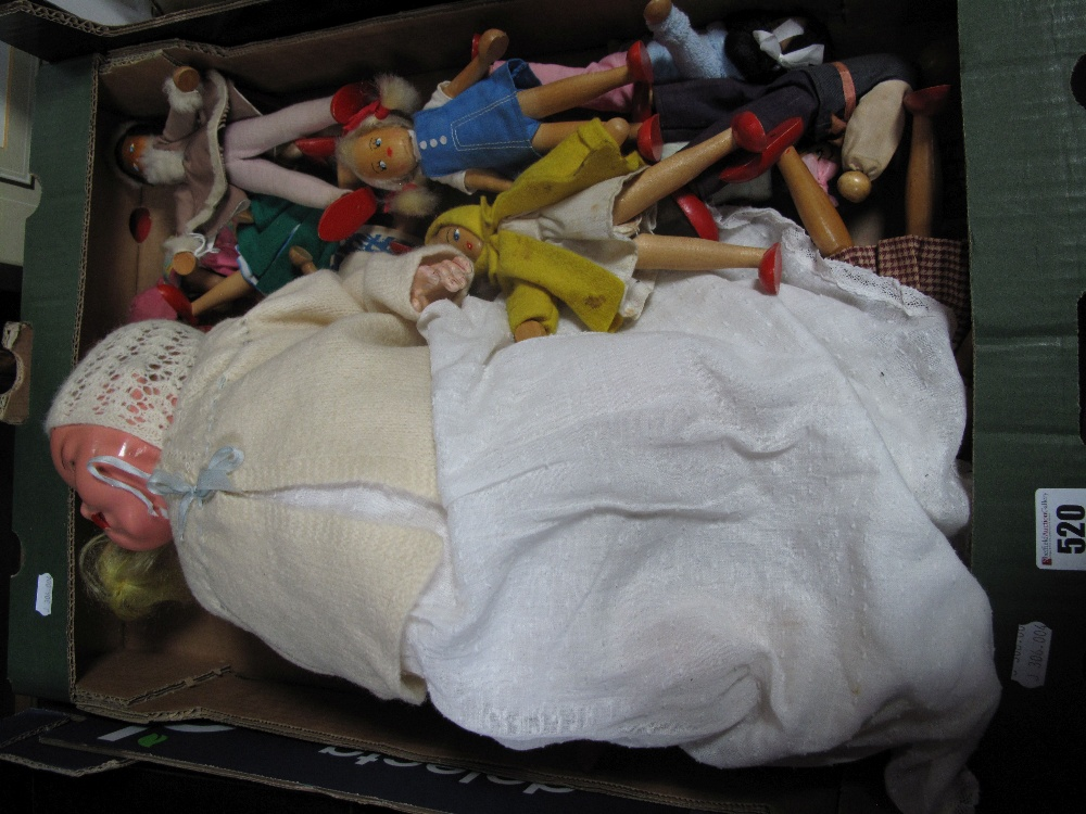 Lot 520 - A Mid XX Century Composition Doll, plus approximately twenty wooden jointed dolls.