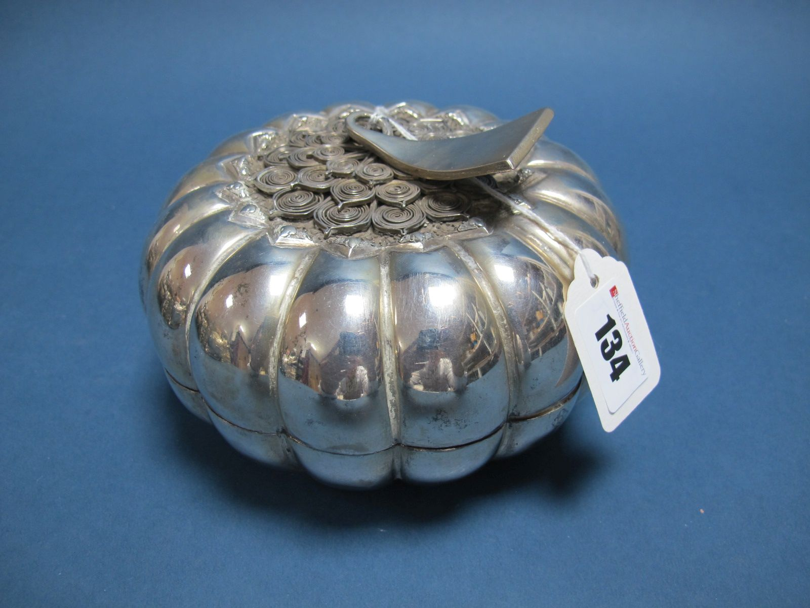 Lot 134 - A Cambodian Decorative Lidded Box, as a stylised pumpkin, with applied scroll detail, stamped ""