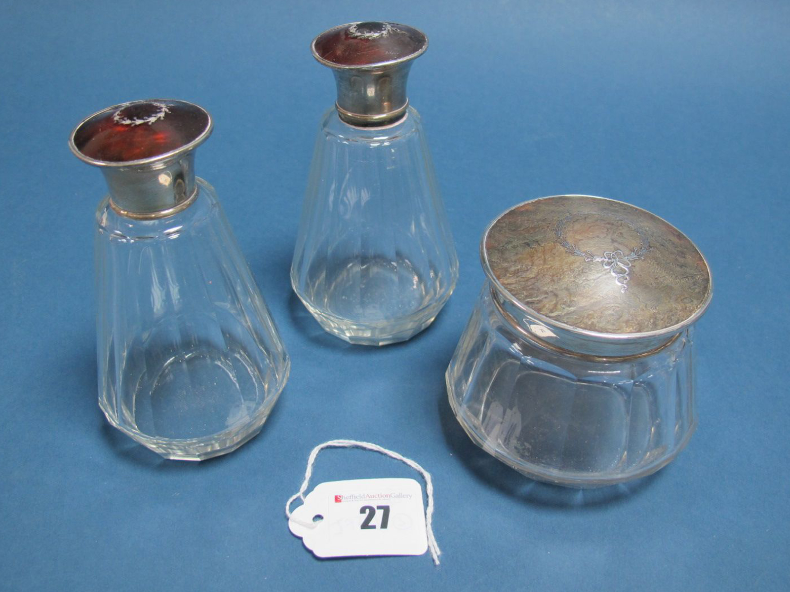 Lot 27 - A Pair of Hallmarked Silver and Piqué Work Topped Glass Bottles, Adie Bros, Birmingham 1927, each of