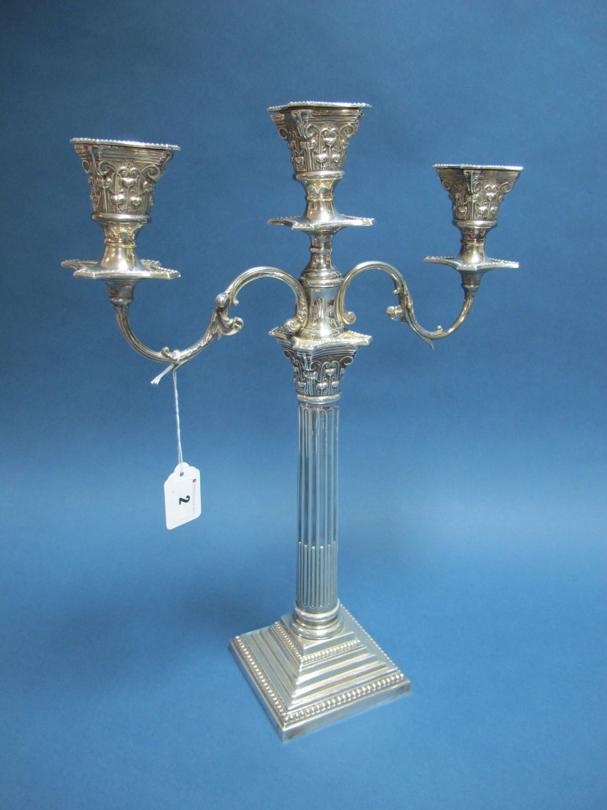 Lot 2 - A Barker-Ellis Plated Twin Branch Three Light Candelabrum, the Corinthian column supporting twin