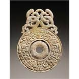 DISC-SHAPED PENDANT WITH DRAGONS Jade. China, Eastern Zhou, 5th - 4th century BCThis small