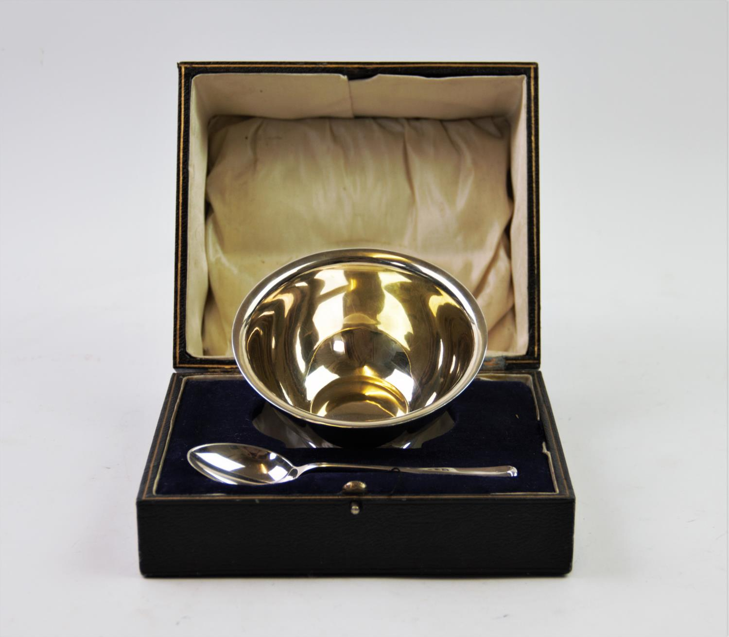 Lot 56 - A George V silver christening set, comprising: a silver bowl, Atkin Brothers, Sheffield 1919, of