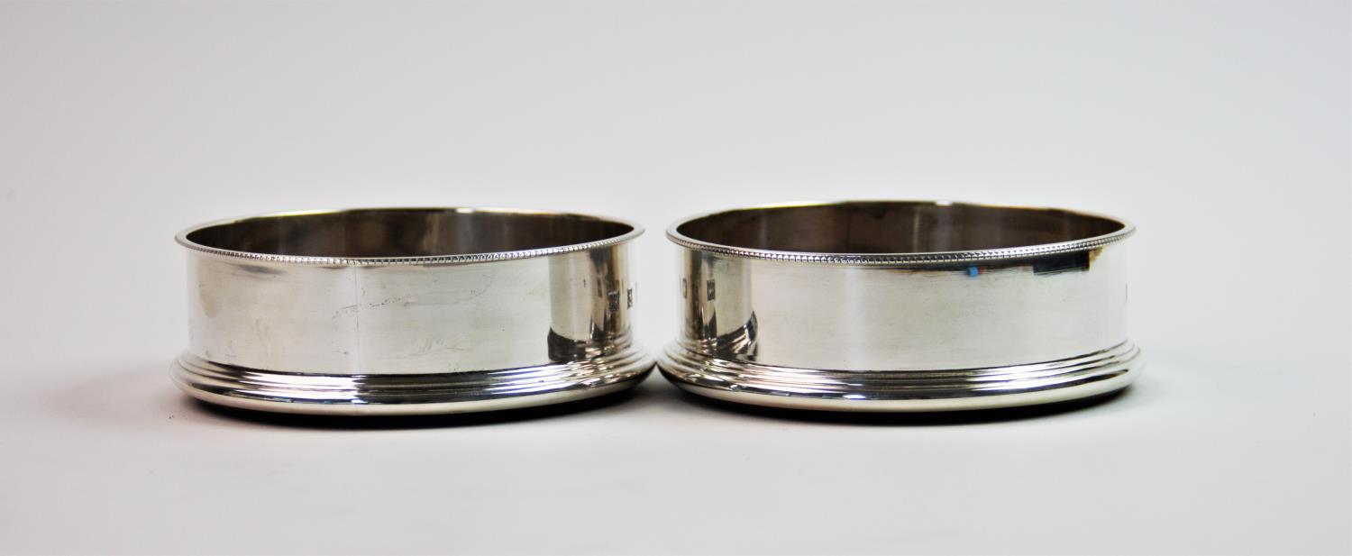 Lot 2 - A pair of silver mounted bottle coasters, P H Vogel & Co, Birmingham 1998, of circular plain