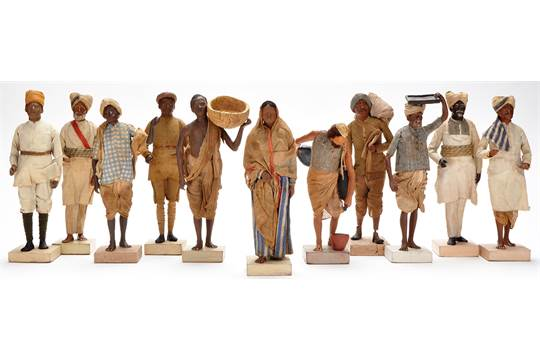 Eleven Indian clay figures, depicting servants and tradesmen, including  water carrier, laundry ma