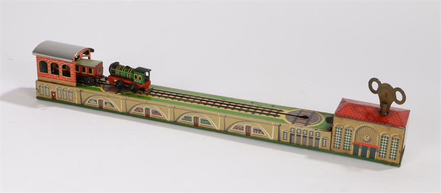 Lot 5 - Tin plate clockwork novelty shunting train, the green tin printed locomotive with A570 to cab sides,