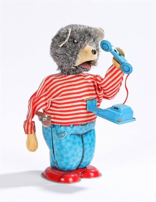 Lot 7 - Clockwork tin plate toy depicting a bear answering a phone, made in Japan, 15.5cm high