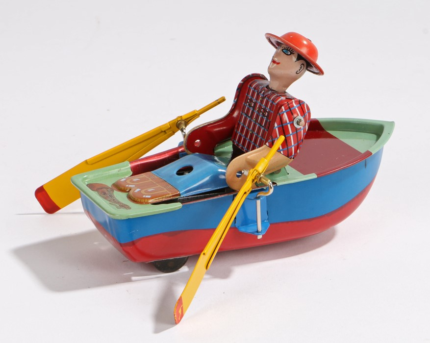Lot 6 - Tin plate clockwork, figure in a rowing boat, made in China