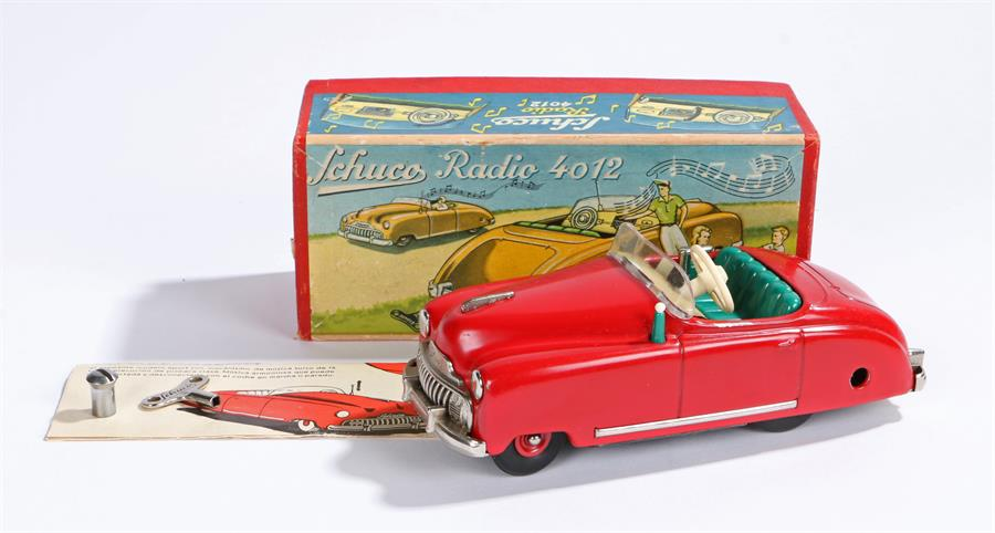 Lot 4 - Schuco Radio 4012 red clockwork car, with key and instructions, housed in original box