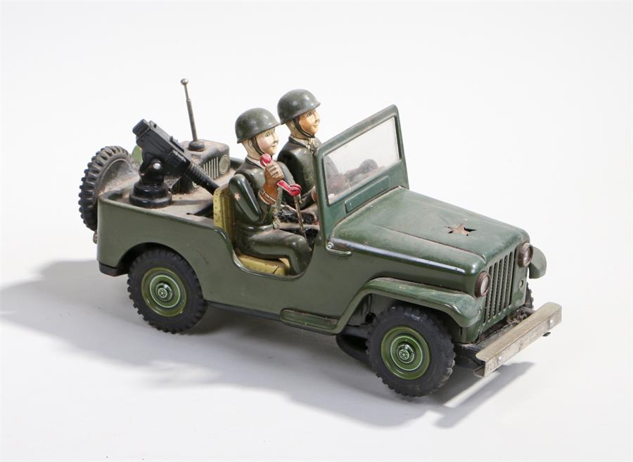 Lot 2 - Tin plate US army jeep, made in Japan, two figures to the front seats, battery operated
