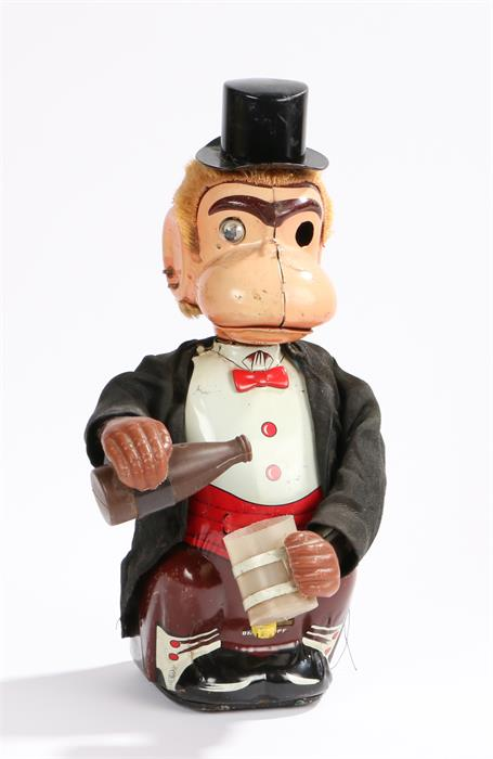 Lot 3 - Tin plate monkey pouring from a bottle, made by Line Mar toys Japan