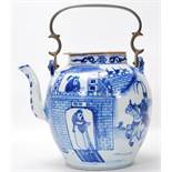 A large 19th Century Chinese blue and white teapot having a bronze carrying handle. The bulbous body