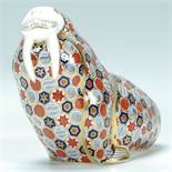 A Royal Crown Derby porcelain paperweight figurine of a walrus being stamped to the underside and