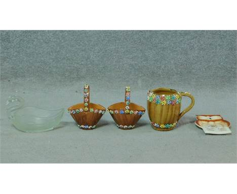 An Italian brown ceramic jug by Elbee, stamped; made in Italy to base, with two matching ceramic baskets with floral relief d