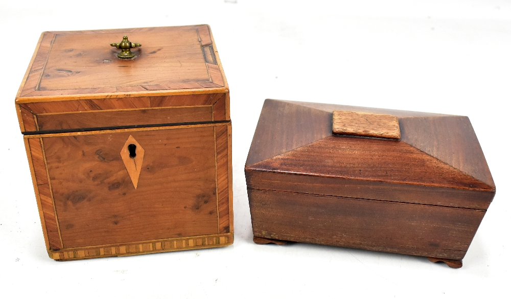 A Georgian yew wood and line inlaid tea caddy, 11 x 12cm, and a mahogany sarcophagus shaped caddy (