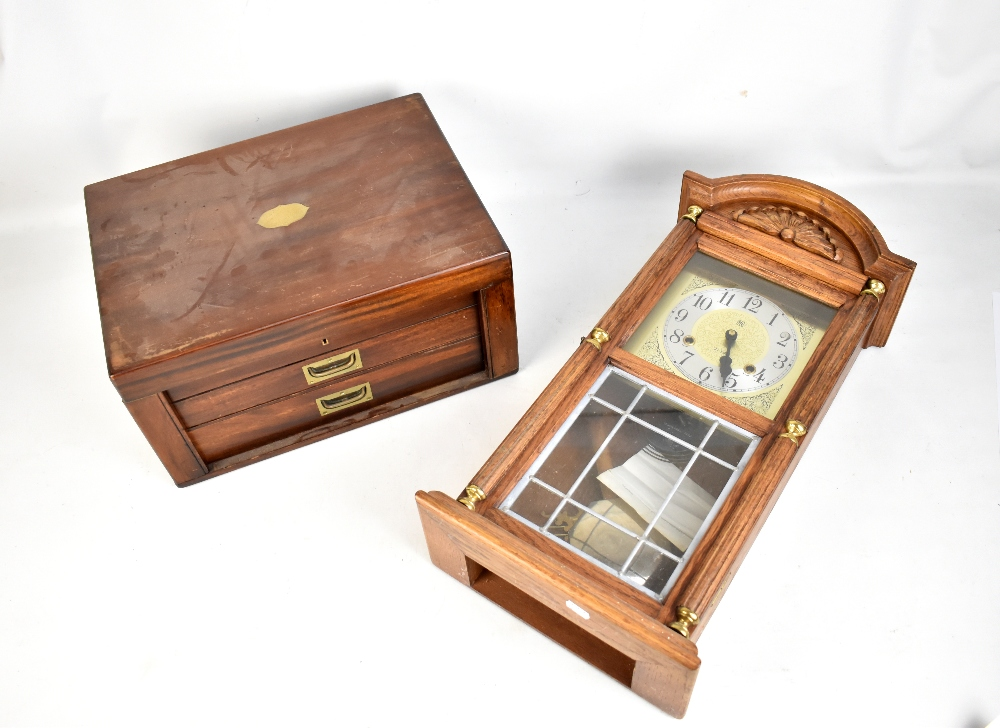 Lot 49 - An early 20th century mahogany canteen (empty), together with a modern oak cased wall clock (2).
