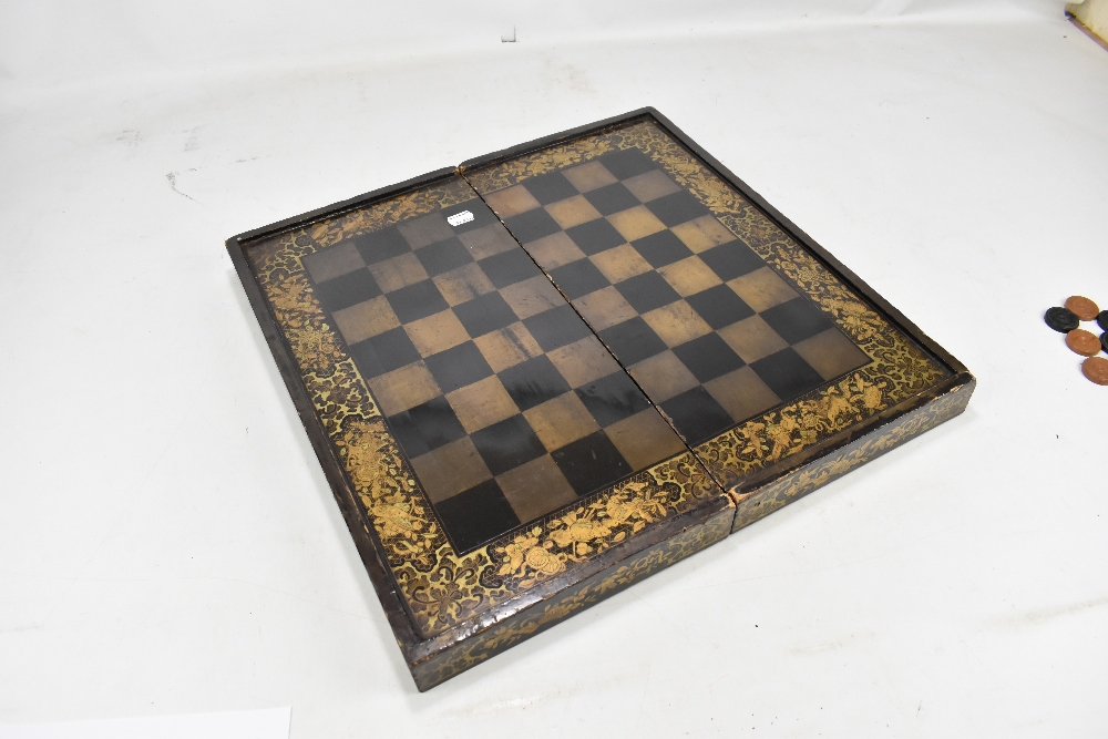 A 19th century Chinese lacquered and gilt games box with chess board to lid and backgammon board - Image 3 of 12