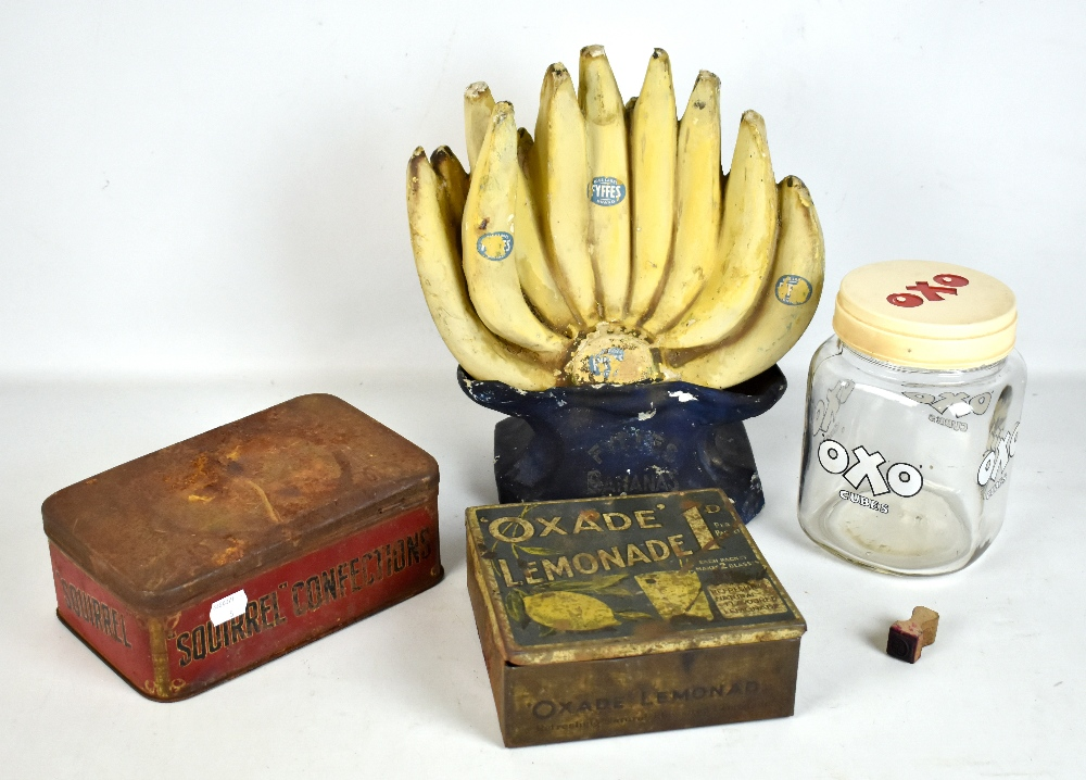 Five pieces of assorted advertising including Fyffes display, height 32cm, Oxade Lemonade tin, OXO