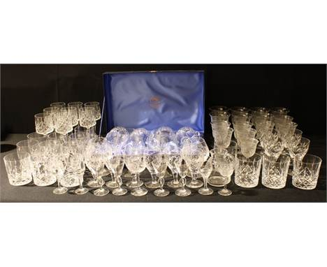 A set of four Thomas Webb Crystal wine glasses, boxed; other cut glass drinking glasses including Stuart; a collection of Edw