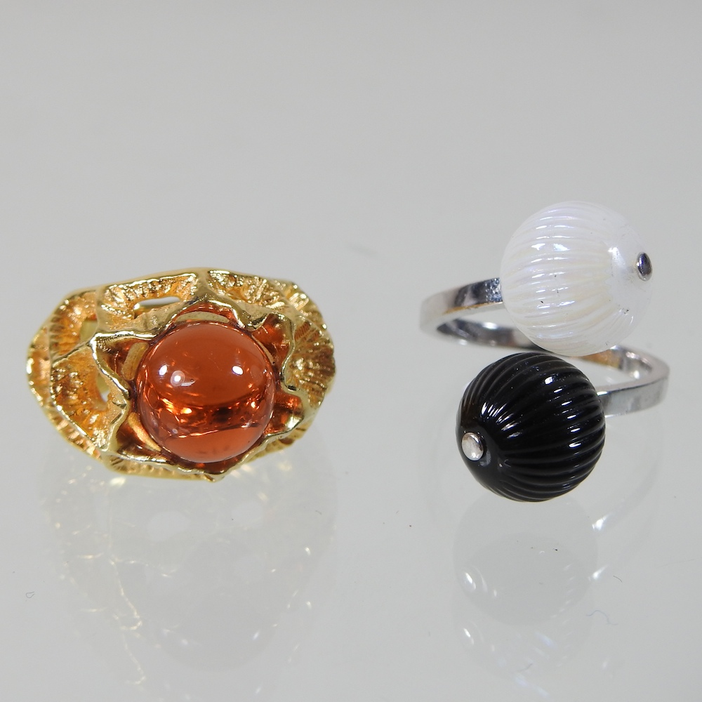 A modern Lalique silver and two colour glass ring, of crossover design,