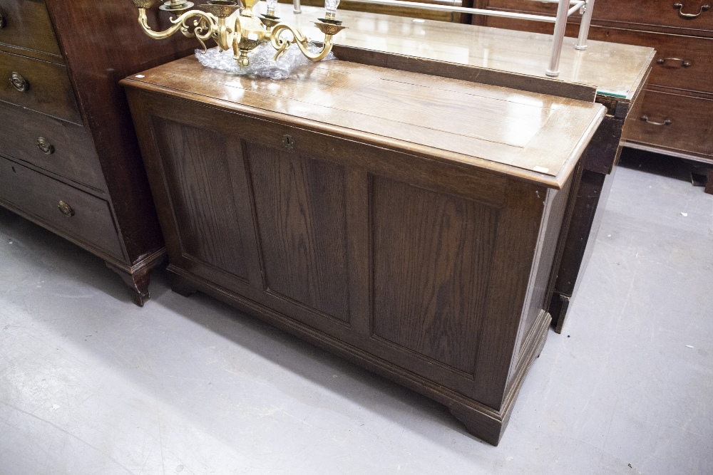 Lot 39 - AN OAK BEDDING BOX, WITH THREE PANEL FRONT