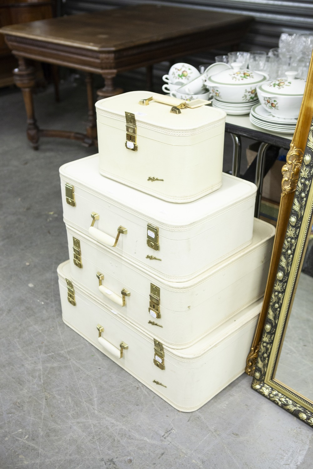 Lot 27 - A SET OF THREE GRADUATED LADY BALTIMORE CIRCA 1970's SUITCASES, AND A MATCHING VANITY CASE (4)