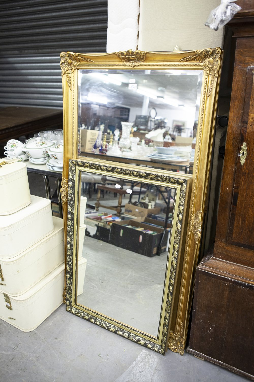 Lot 28 - A LARGE GILT FRAMED WALL MIRROR AND A SMALLER GILT FRAMED MIRROR (2)