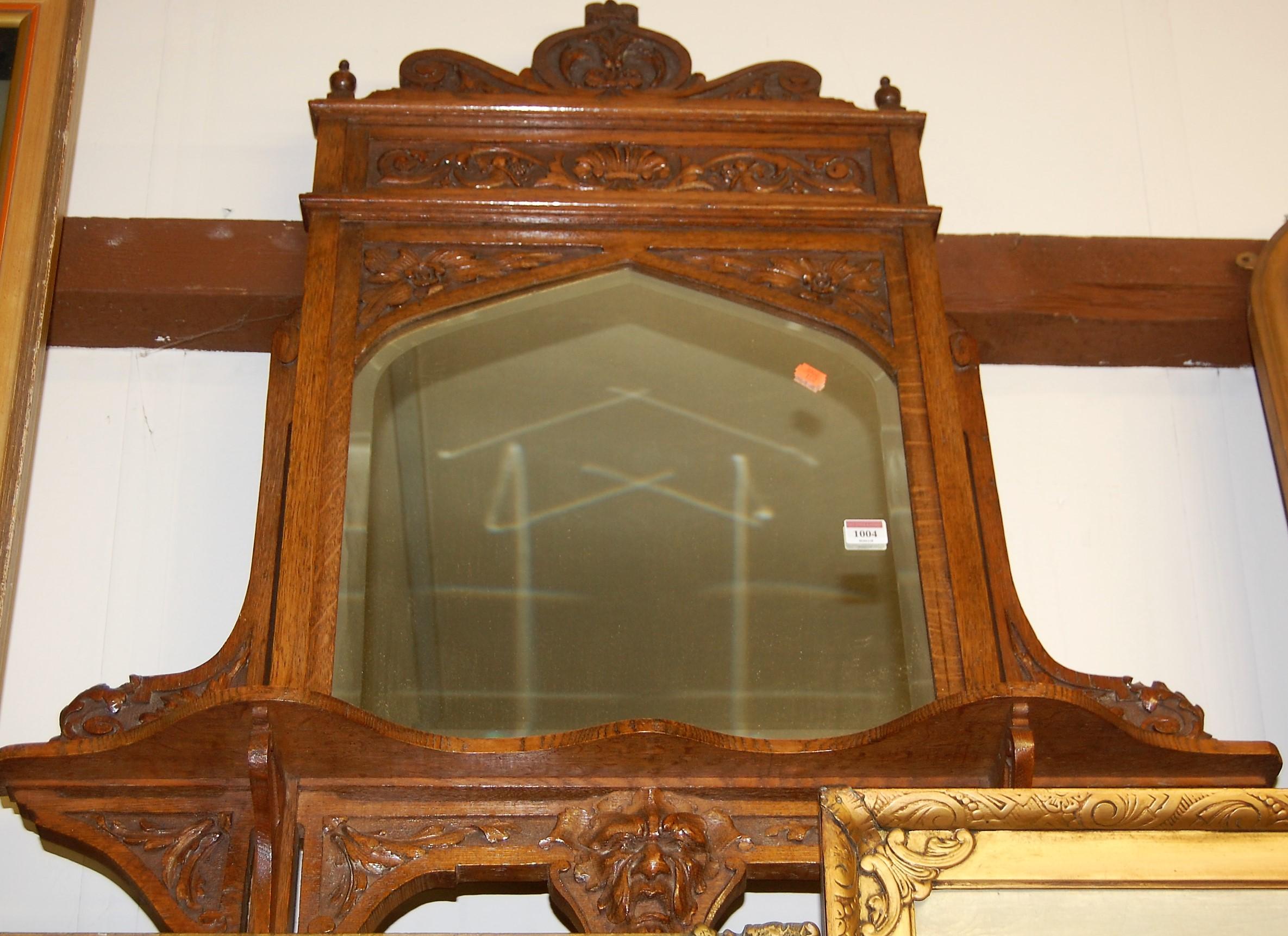 Lot 1004 - A circa 1900 carved oak wall mirror, 97 x 88cm