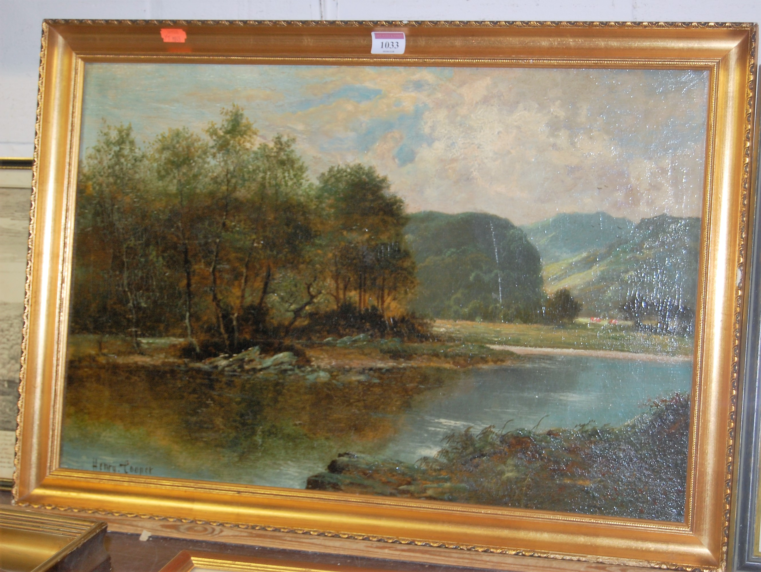 Lot 1033 - Henry Cooper - Cattle grazing in a North Wales valley, oil on card, signed lower left, 39 x 59cm