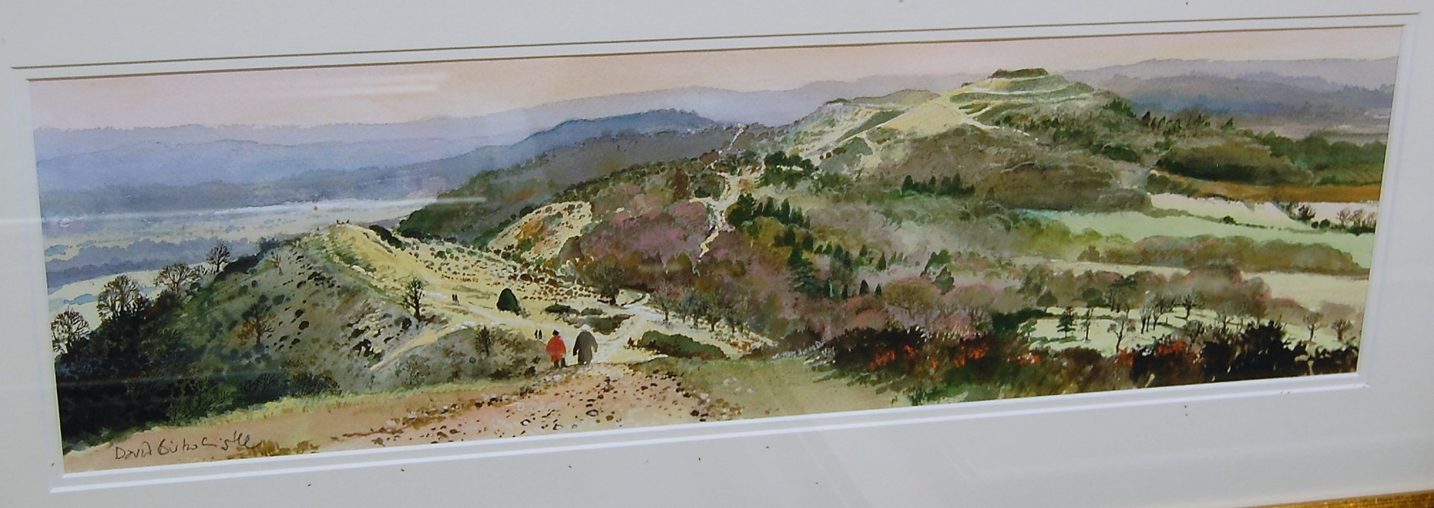Lot 1042 - David Birtwhistle - Winter walk along the Malvern Ridge, watercolour, signed lower left, 16 x 53.