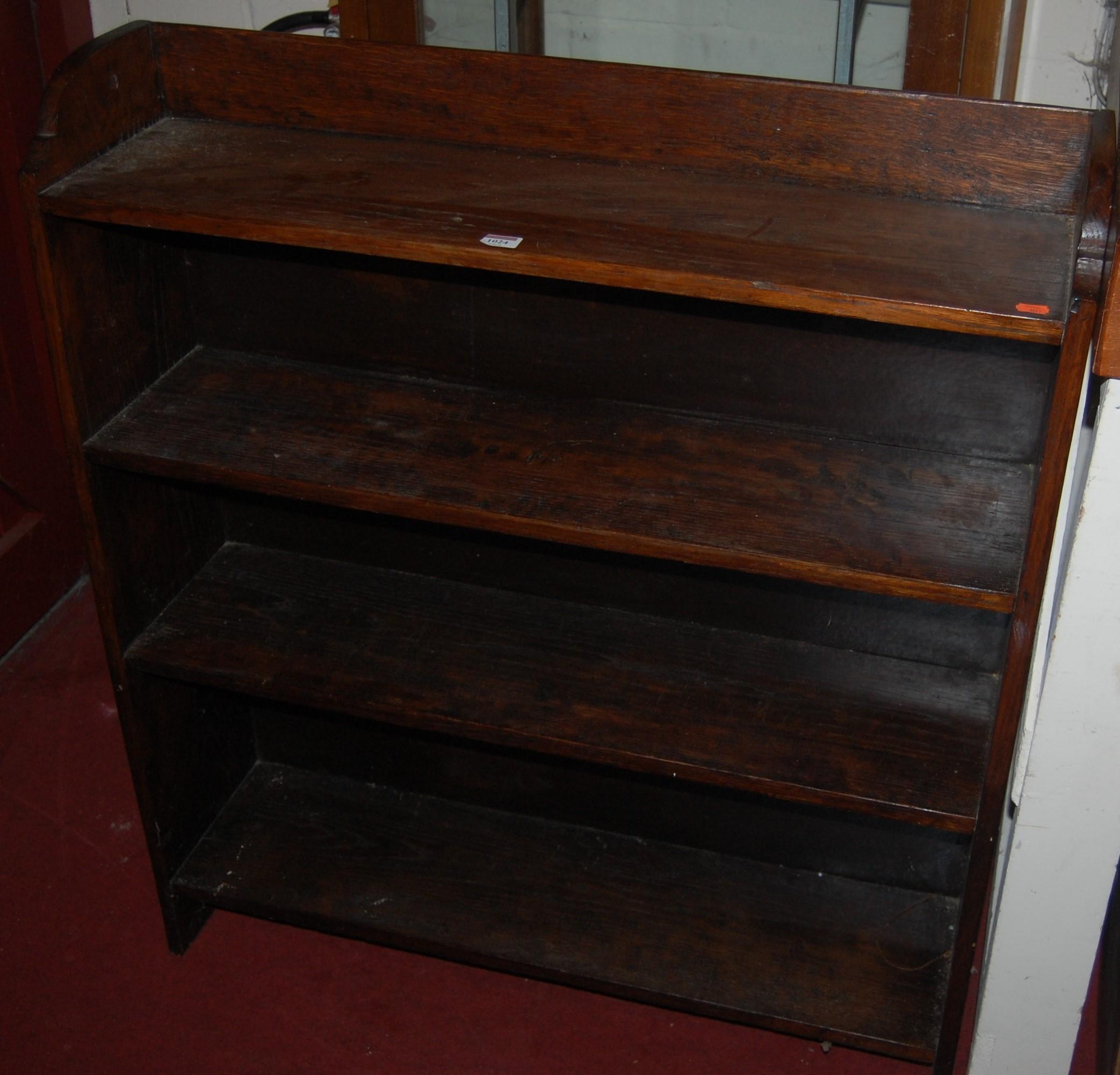 Lot 1024 - A 1930s oak open bookshelf, w.91.5cm