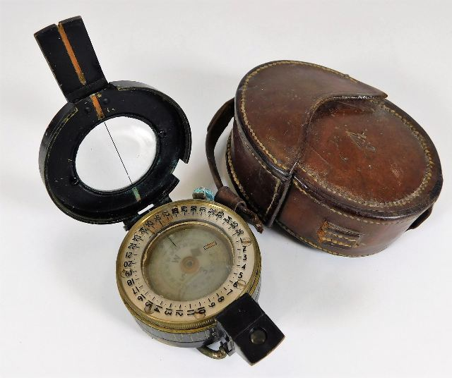 Lot 336 - A WW2 brass military compass with case dated 1943