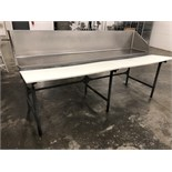S/S Butcher table with stainless steel back panel and plastic butcher blocks approximately 8' Long