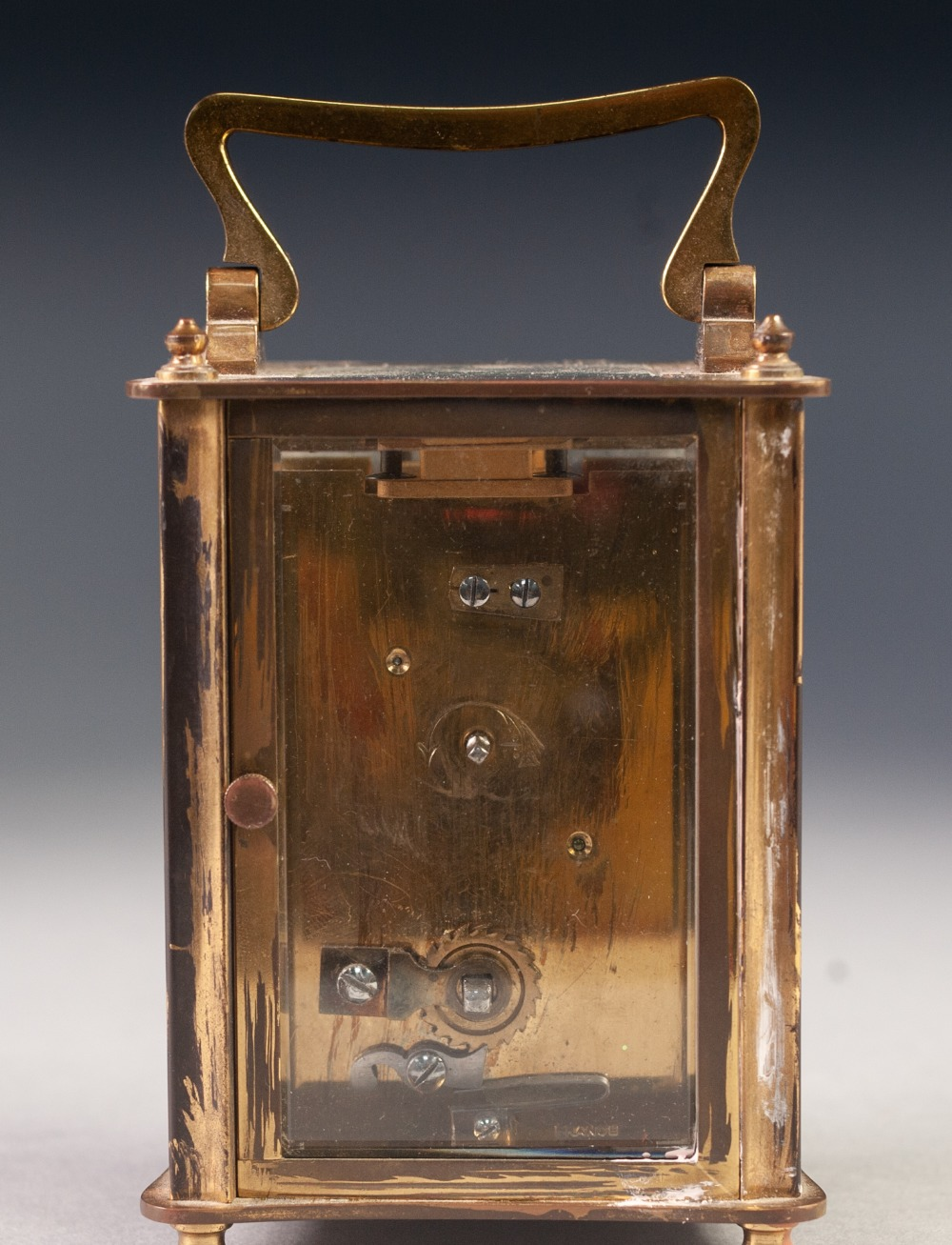 Lot 40 - A MID TWENTIETH CENTURY BRASS CASED CARRIAGE CLOCK of typical form with oblong white dial, black