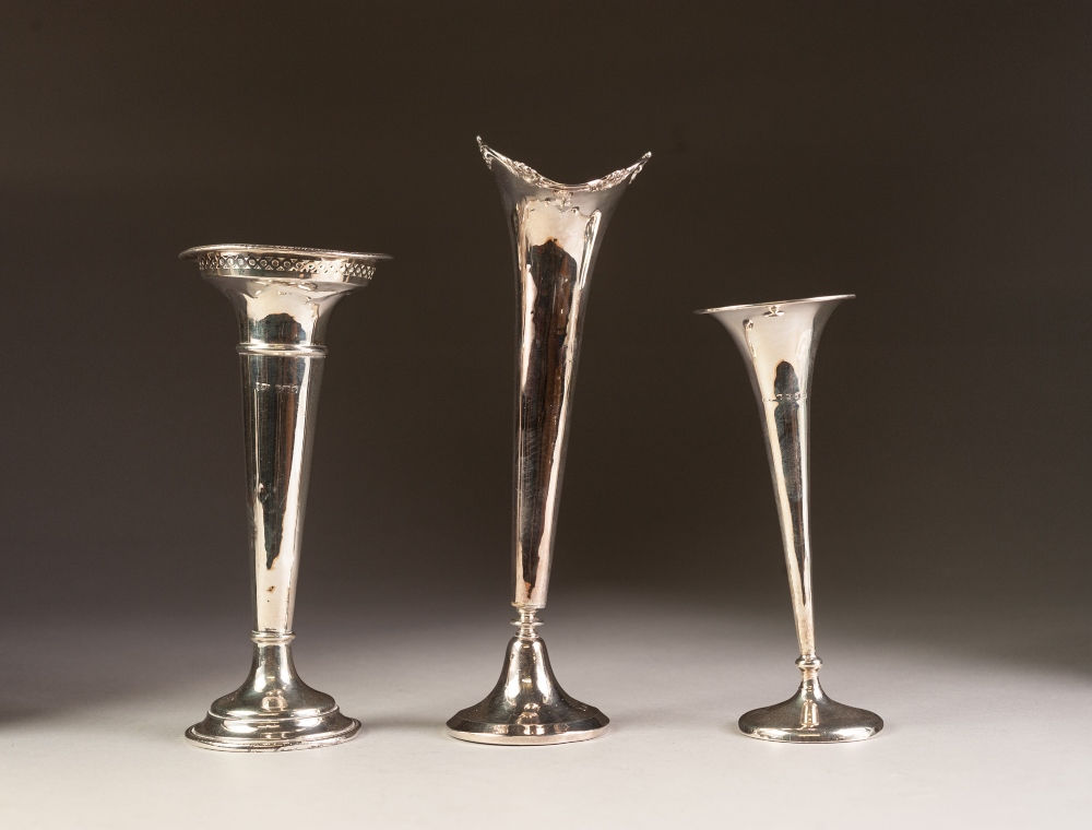Lot 317 - THREE EARLY 20th CENTURY WEIGHTED SILVER FLOWER VASES (marks rubbed) (3)