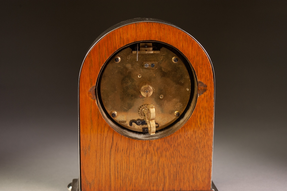 Lot 250 - INTER-WAR YEARS ENGINE TURNED SILVER CASED DOME-TOP MANTEL CLOCK, standing on compressed ball