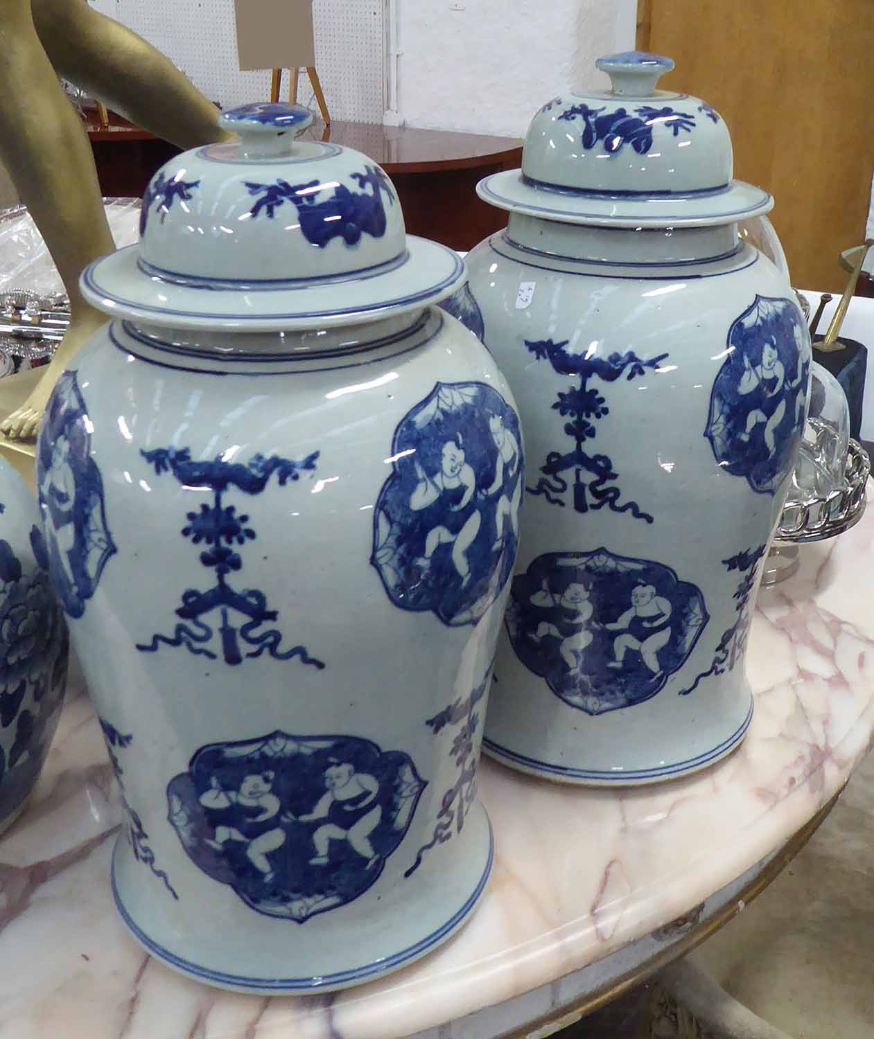 Lot 41 - TEMPLE JARS, a pair, Chinese style blue and white, 43cm H.